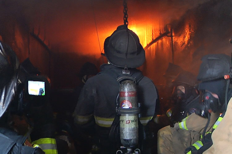 Firefighters in a flashover simulator