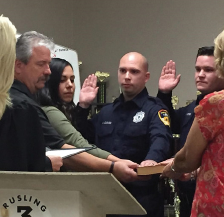 Brian Correia taking the oath as he became a career firefighter in October 2016. (Photo by Susan Correia.)