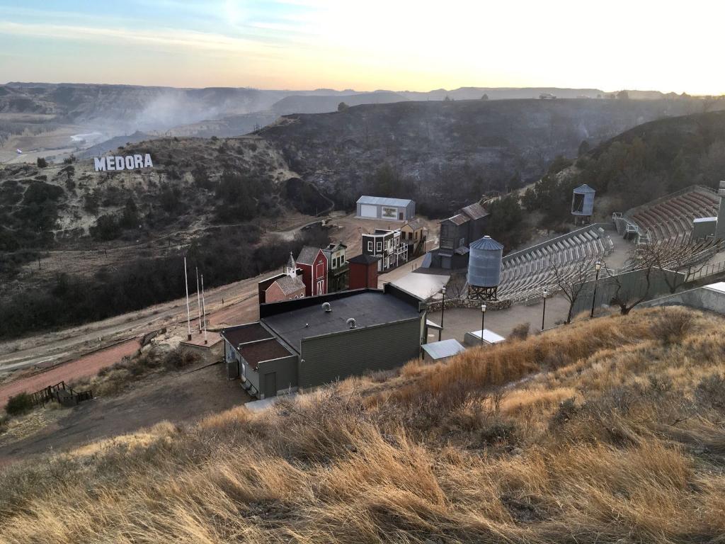 A wildfire smolders near the Burning Hills Amphitheatre Thursday, April 1, 2021 near Medora, N.D.