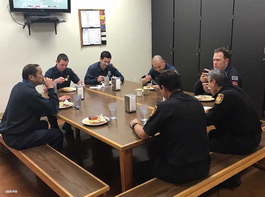 Firefighters eating at kichen table