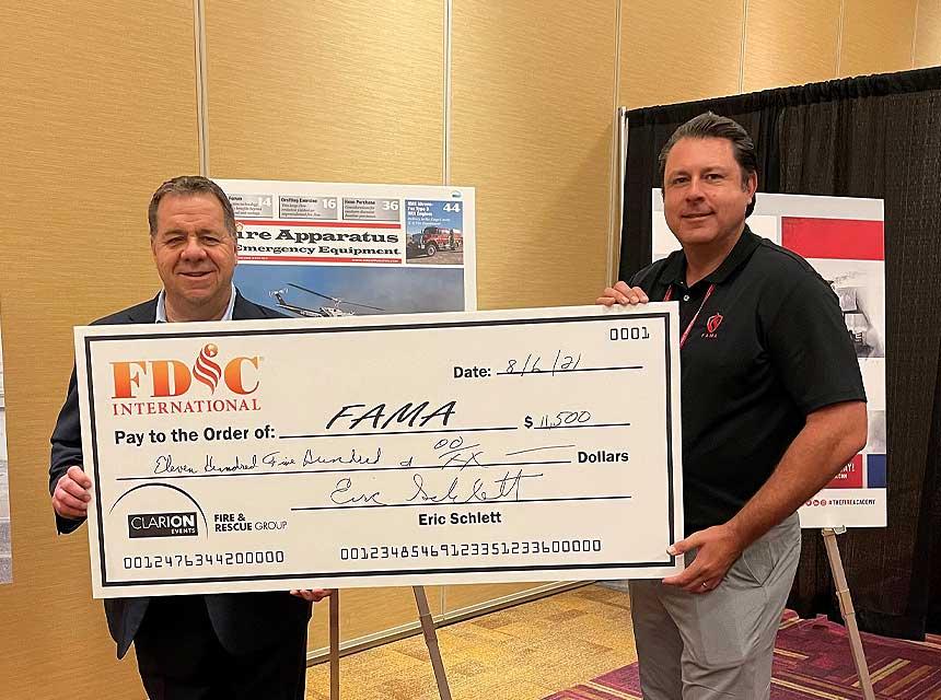 Eric Schlett presents check to FAMA