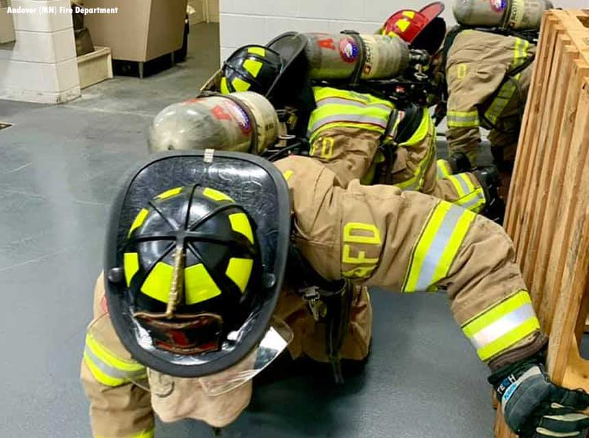 During training, firefighters with blacked out vision attempt to find their way