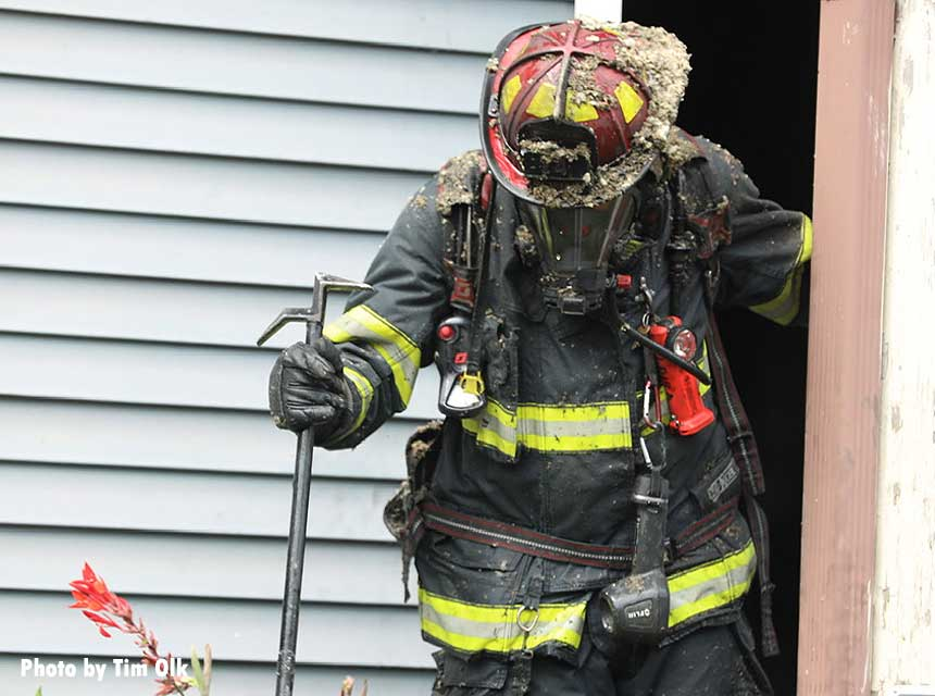 Firefighter at the scene of a house fire in Indianapolis