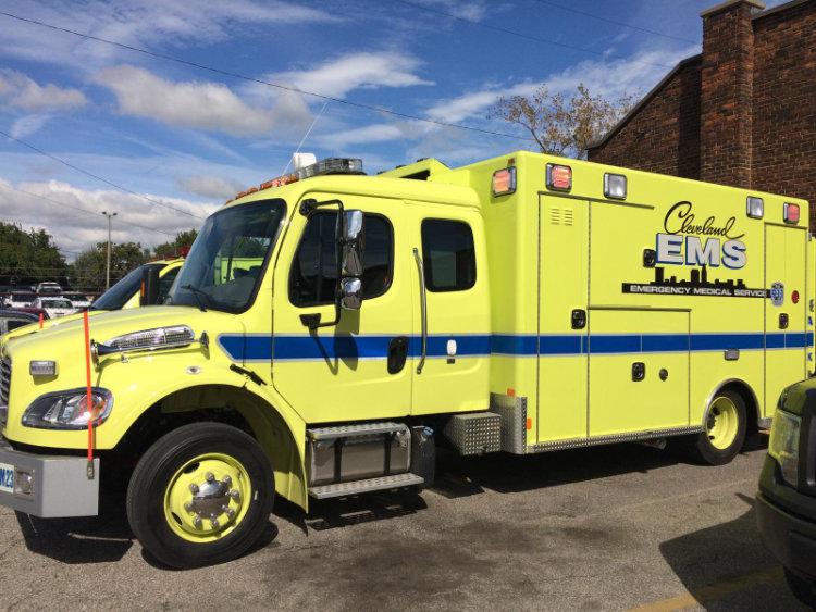 A yellow Cleveland EMS ambulance.