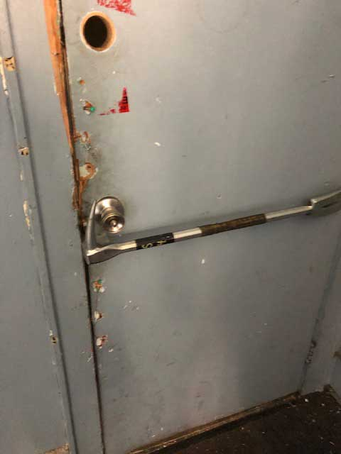 Place the adz of the halligan as you normally would for an outward door