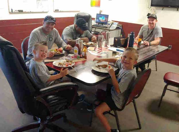 Rescuers with kids in a diner